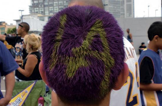 A young Laker fan flaunts his LA pride with his hair sprayed head.