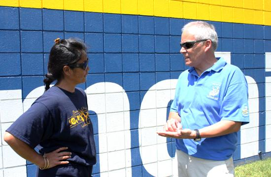 New Samohi Athletic Director Daniel Escalera and Samohi volleyball coach Liane Sato talk shop outside of Santa Monica High School. Escalera