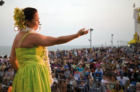 An enthusiastic audience enjoys a one of last year's performers in the 2009 Twilight Dance concert at the pier.