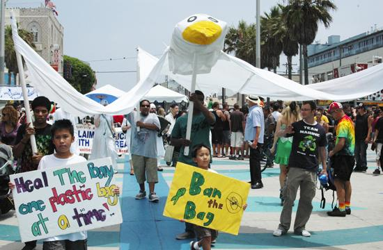 "At noon the ""One Planet Parade"" marched down Ocean Front walk led by a large goose display with elaborately dressed performers and children calling for a plastic bag ban in tow at the 2010 Venice Eco-Fest on Venice Beach and boardwalk."