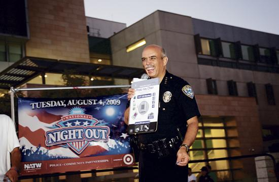 Santa Monica Police Chief of Police Timothy Jackman has a laugh while presenting raffle prizes at the end of the last year's National Night Out with a block party in front of the Public Safety Facility on Olympic Drive on Tuesday