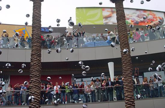 Santa Monica Place employees threw beach balls to the crowd as part of the opening ceremony.