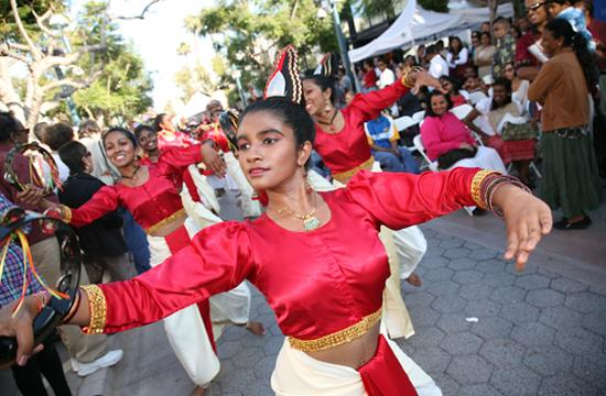 Thilakshi Peris leads the adult troupe of the Sapthabhumi dance troupe at the Sri Lanka Day Festival at the Third Street Promenade in Santa Monica on Saturday August 7.