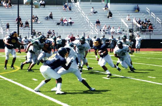 Vikings' Brandon Taylor rushes during the scrimmage at South Torrance High on Friday.