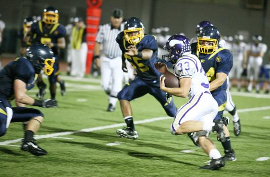Samohi defense moves in on Valencia running back Steven Manfro. Manfro scored four touchdowns in a 63-28 loss for the Vikings at Corsair Field on Friday