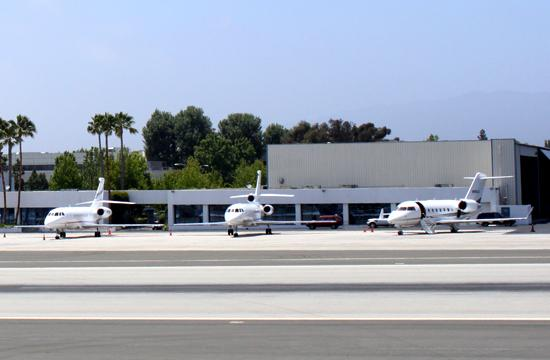 Small jets sit on the runway at Santa Monica Airport (SMO).
