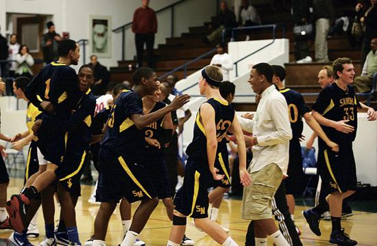 Above: The Vikings celebrate a 56-54 win against Serra of Gardena at Samohi on Tuesday