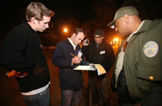 (L-R) John Madigan and Brian Chase (Santa Monica Chamber of Commerce) and Robert Kronovet (Rent Control Board) assisted by Park Ranger Roger Gray, checked their statistics sheet at Palisades Park, at1.30am on Thursday, Jan. 28 during the Santa Monica 2010 Homeless Count.