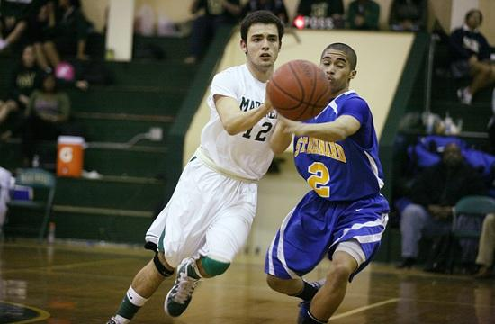 St. Monica guard Nick Chaidez reaches for the ball against a St. Bernard player during the Jan. 27 game. St. Bernard won 77-60.