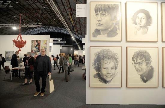 Visitors look at art at the Art Los Angeles Contemporary art fair held Jan. 27 to 30 at Barker Hangar in Santa Monica.