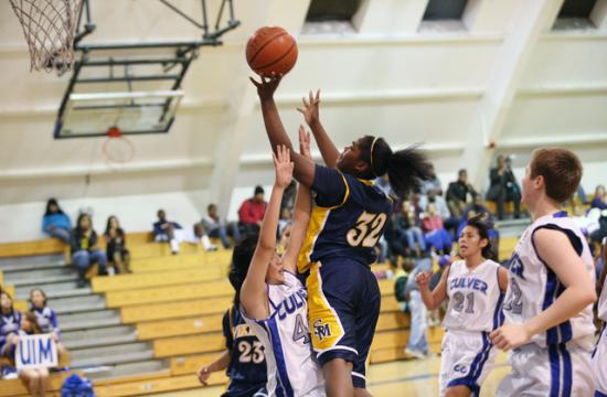 Santa Monica's Briana Harris goes up for a shot over a Culver City defender on Wednesday