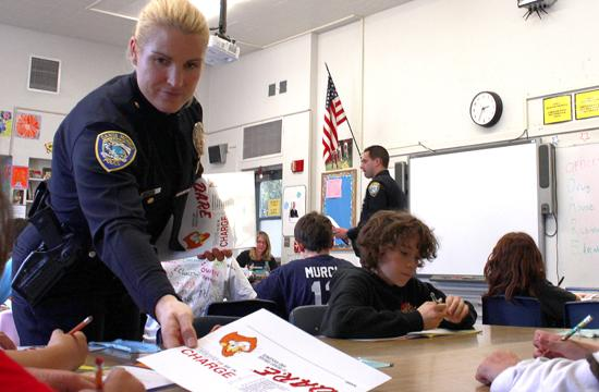 Police Activities League (PAL) officer Jenifer Rodriguez hands out D.A.R.E. name tags to Grant Elementary fifth grade students on Feb. 8 in Santa Monica. Her partner
