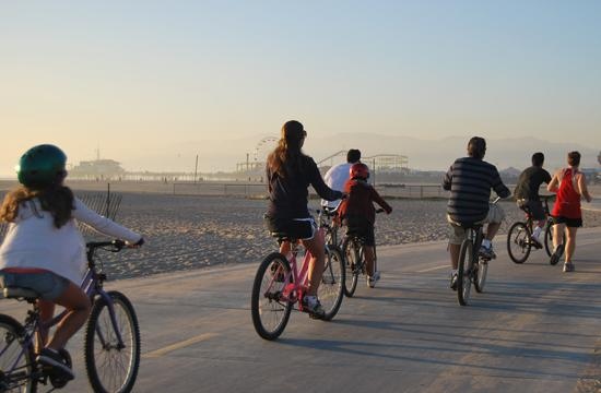 Pedestrians and Bicyclists mingle on the bike path along Santa Monica Beach.
