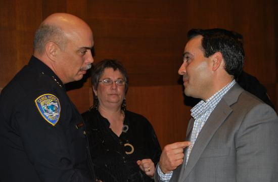 Santa Monica Police Department Chief Timothy Jackman (left) and Santa Monica-Malibu Unified School District Board member Oscar de la Torre (Right) talk immediately after a discussion before the Santa Monica City Council about the police department's questionable investigation practices against de la Torre.