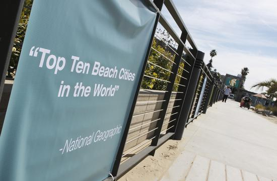A banner showcases Santa Monica's inclusion on National Geographic's list of Top Ten Beach Cities in the world.