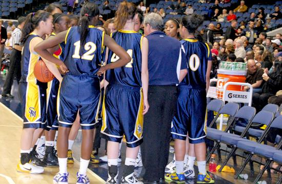 Coach Marty Verdugo plans with the Santa Monica High School girls basketball team.