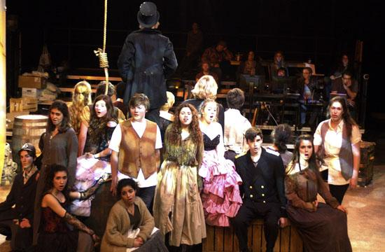 """The ensemble sings as the hangman prepares for Mack's execution in """"The Threepenny Opera."""""""