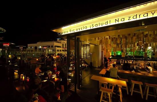 Sonoma Wine Garden's wine bar opens up to a deck with lounge seating and ocean views at Santa Monica Place.