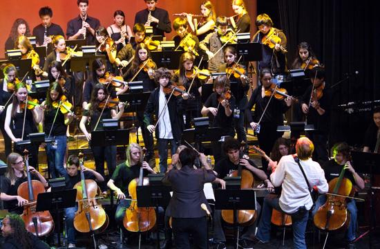Richard Page (lower right) performing with the Santa Monica High School Orchestra at Santa Monica High School's Barnun Hall for the eighth annual For The Arts concert.