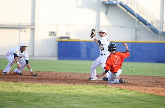 Christian Rodriguez (C) gets the out at second and attempts a double-play. The Vikings lost 7-3 to Hawthorne.