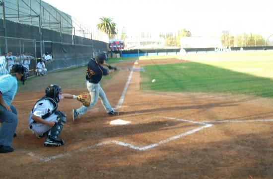 Santa Monica High School's David Tyre-vigil hitting the ball off of Loyola High Cubs' Pitcher Xavier Borde.