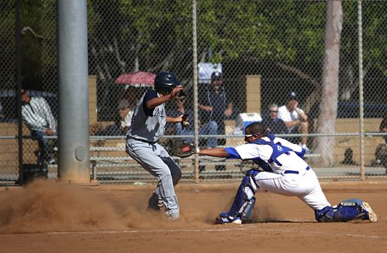 Roadrunners catcher Jake Berg-Rosenblatt fails to get the out as Josh Brodsky scores for Montclair Prep in an 8-1 loss for Crossroads at Clover Park on Tuesday