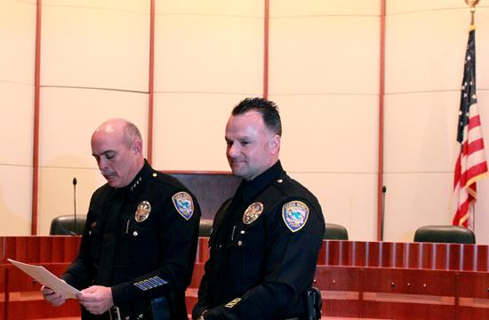 Officer Benito Seli (right) was honored before a packed City Council chamber at Santa Monica City Hall on March 21