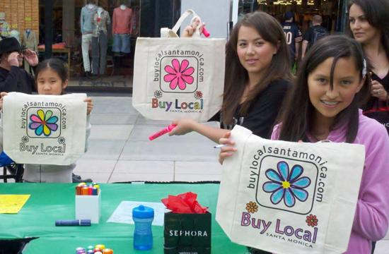 Local children display Buy Local bag at the Thirds Street Promenade