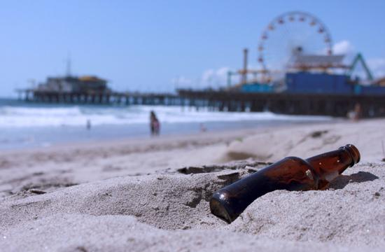 A beer bottle in the sand at Santa Monica Beach