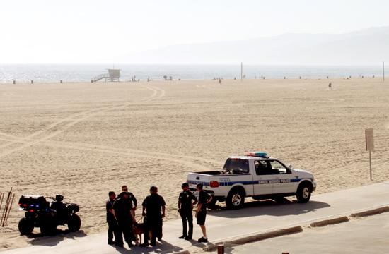 Santa Monica police survey the scene at the 1200 block of the Santa Monica Beach where two explosive devices were found Friday