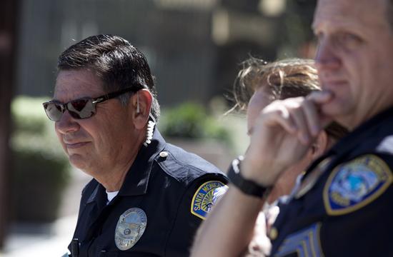 Santa Monica Police survey the scene of a jewelry heist in Santa Monica.