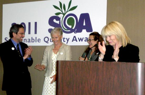 Santa Monica Chamber of Commerce President and CEO Laurel Rosen (right) announced an award with Mayor Richard Bloom (left) at the 2011 Sustainable Quality Awards in Santa Monica.