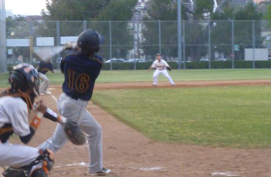 Samohi's Matthew Stancil drives in one of his RBI's against Beverly Hills on Thursday.