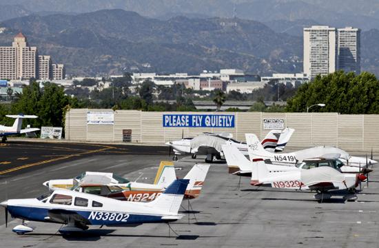 Propeller planes parked off the runway at Santa Monica Airport