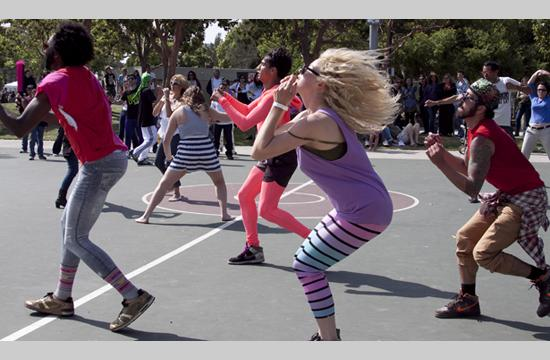 """Dancers from The Sweat Spot Dance Space engage festival attendees in choreographing a """"Dance Attack"""" routine at the 20th Annual Santa Monica Festival in Clover Park"""