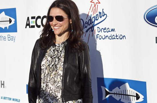 Julia Louis-Dreyfus poses for pictures at Heal the Bay's Annual Bring Back the Beach Bash on Thursday.