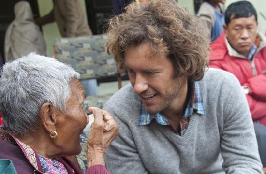 CEO and founder of the Santa Monica-based TOMS organization Blake Mycoskie learns about cataract surgery from a patient in Nepal. Mycoskie has released a line of TOMS Eyewear as the next product of the One for One movement.