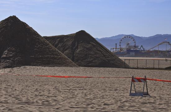 Sand piles on the Santa Monica Beach seen last week have since filled in and plugged the Pico-Kenter Drain at the end of Pico Boulevard.