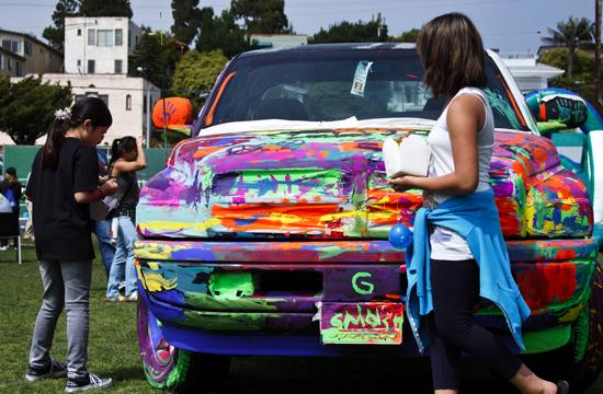 Students brush up on their art skills at the Paint My Ride attraction during Santa Monica Alternative Schoolhouse's SuperSMASH '11