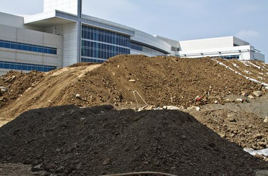 Pile of dirt outside St. John's construction site.
