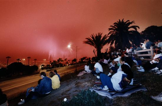 People scattered along the bluffs next to the Santa Monica Pier expected a colorful fireworks display during the anual Dawn's Early Light show