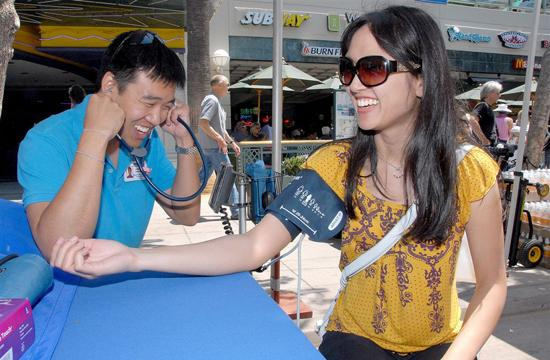 Dr. Lawrence Hwang checks 28-year-old Kim Nguyen's blood pressure during last year's 25th Annual Santa Monica Chamber of Commerce's Health and Fitness Festival at the Third Street Promenade on July 17