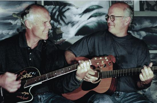 Headliners Gil Orr (left) and Paul Johnson (right) of the Duo-Tones share a magical moment playing dual acoustic guitars to accompany their endless ride in search for the quintessence of surf music.""