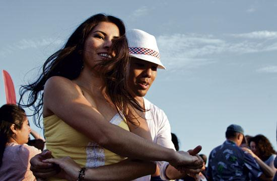 Yessenia Munot and Ryan Jhono salsa their way around the pier dance floor to sounds of the L.A. Salsa AllStars at the 27th Annual Twilight Dance Series