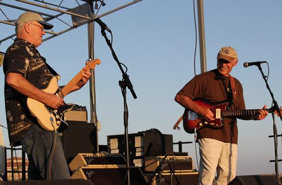 Paul Johnson (left) and Gil Orr of the Duo-Tones begin the evening theme of 'Surf Guitar' with classic surf sounds during the daylight hours of the Twilight Dance Series on the Santa Monica Pier.