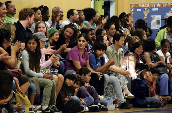 A crowd of parents and children gather in the gym during the summer showcase at the Santa Monica Boys and Girls Club on Tuesday.