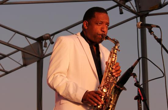 Donald Harrison belts out some smooth saxophone power under the moon light.