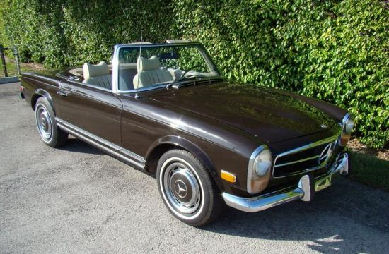 A brown 1970 Mercedes-Benz 280SL - similar to the one stolen owned by John Travolta.