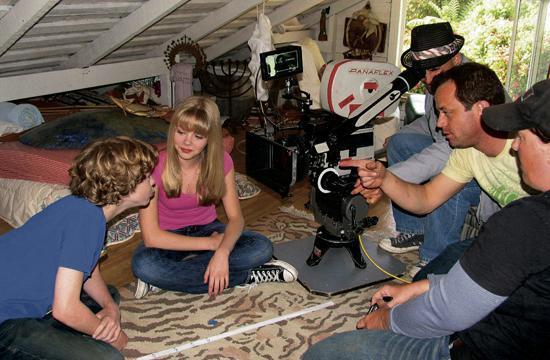 "David Katz (yellow shirt) directs a scene from his film ""Kissing Strangers""."