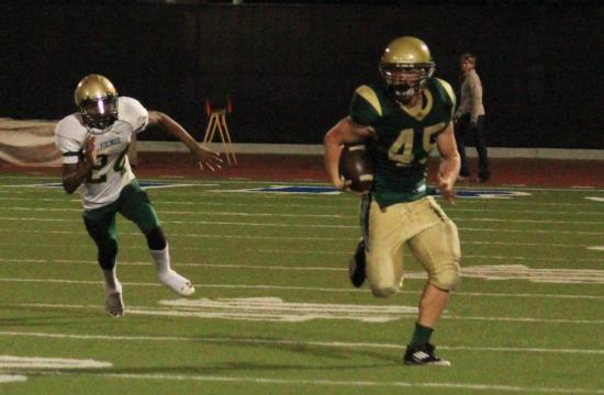 St. Monica fullback Kevin Holubowski runs into the open field against Blair on Friday night. Holubowski scored three touchdowns for the Mariners in the win.